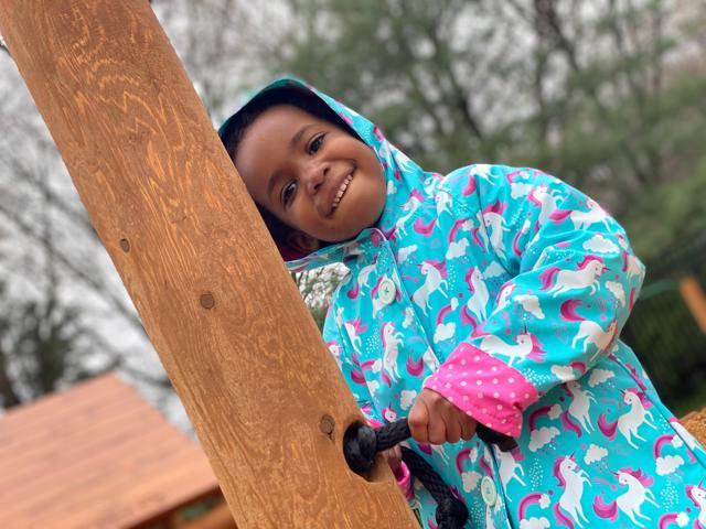 happy children on playground at Montessori school