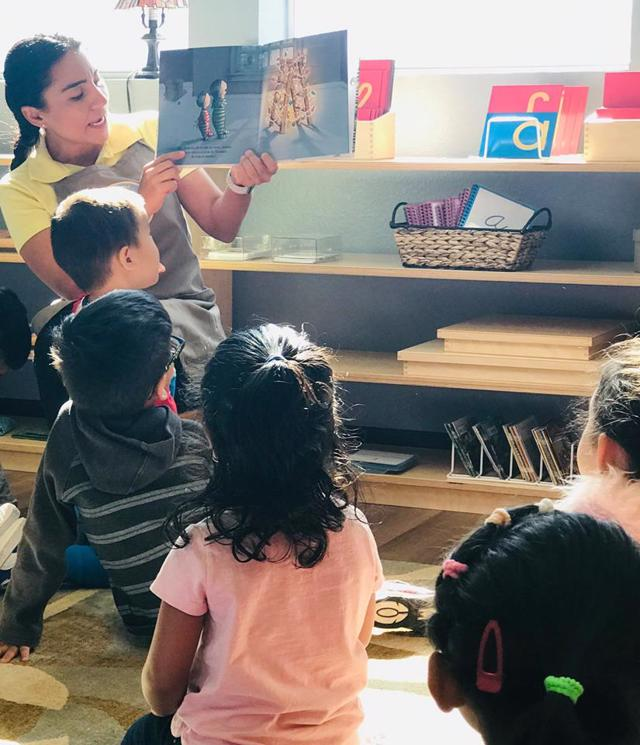 Ms. Monica reads to the Children's House Spanish immersion class at Guidepost Montessori in Frisco TX