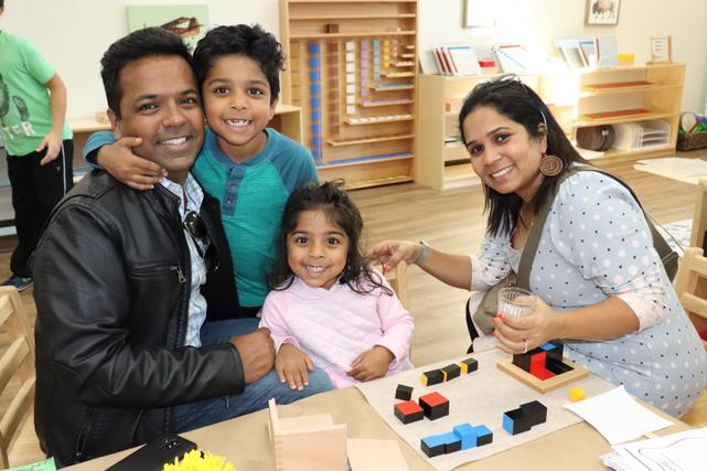 Family works on the trinomial cube at Guidepost Montessori, a Frisco, tx private school