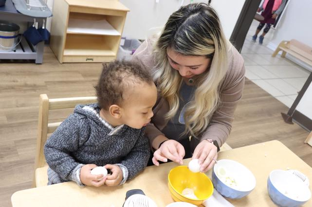 Best Private Montessori School Frisco, TX | Guide shows student how to peel eggs to make a snack | Guidepost Montessori