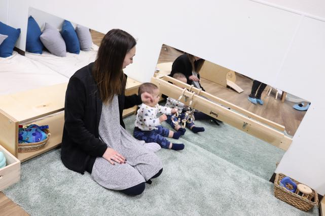 Nido baby grasping beads that help him with his psychomotor development at Guidepost Montessori in Frisco, TX | Private School