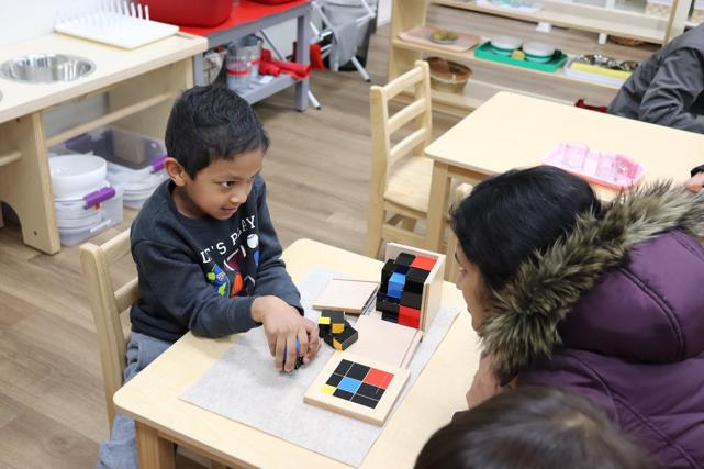 Student impresses his mom with the construction of the trinomial cube! This is the physical construction of the cube of a trinomial, (a+b+c)^3 at Guidepost Montessori at Stonebriar, Frisco tx