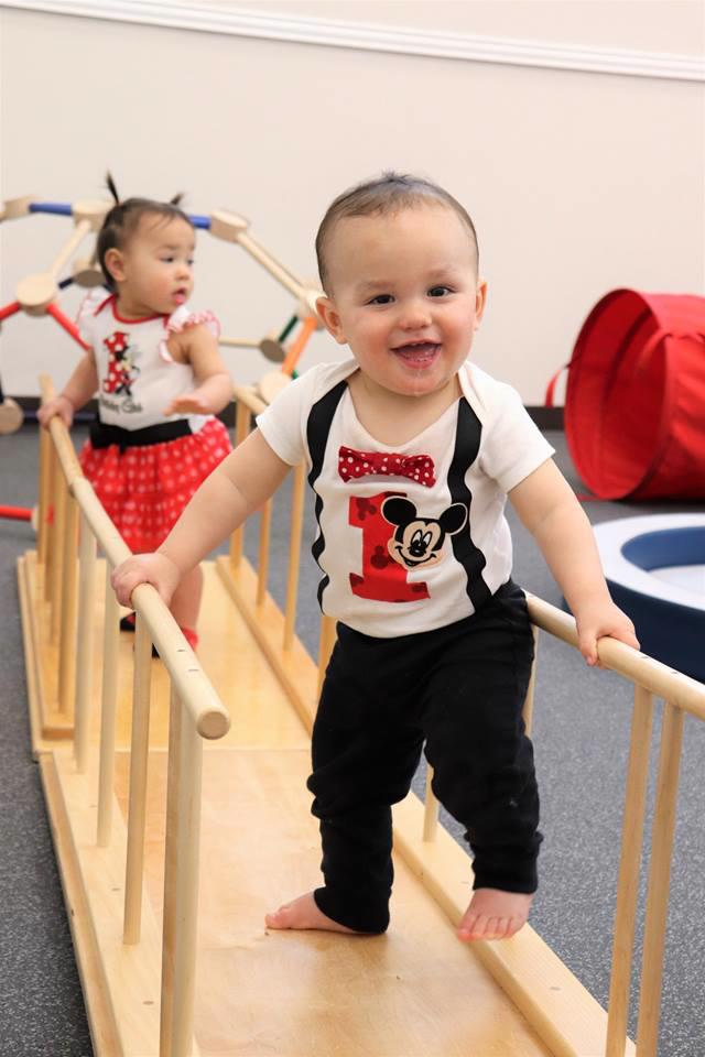 Nido students turn 1 years old working on their balance and gross motor skills at Guidepost Montessori in Frisco, TX