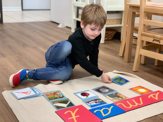 Student develops language by letter sounds and sorting at Guidepost Montessori at Stonebriar in Frisco TX